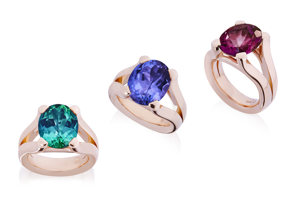 Solitaire ring in rose gold wiht different colorful big gem stones.
